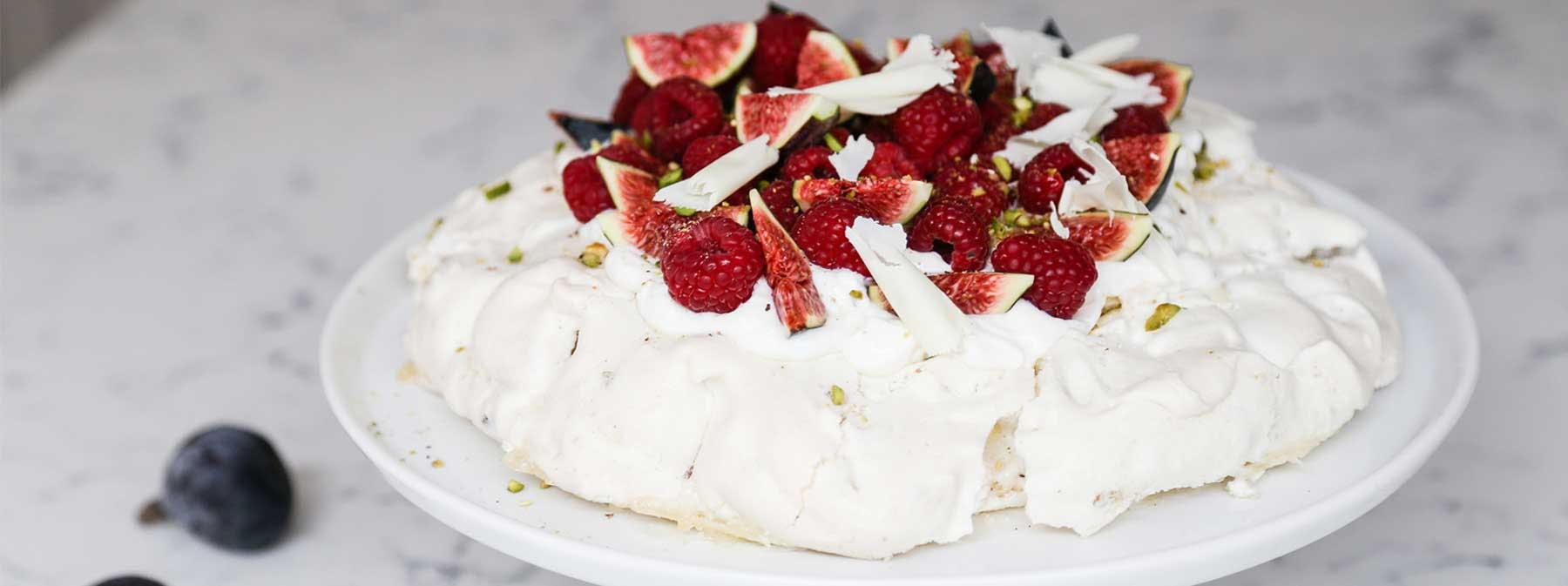 Signature Recipes | White chocolate, rasberry & pistachio pavlova
